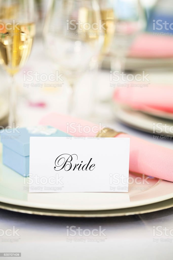 'Bride' Place Card, Napkin And Wedding Favor On Plate stock photo