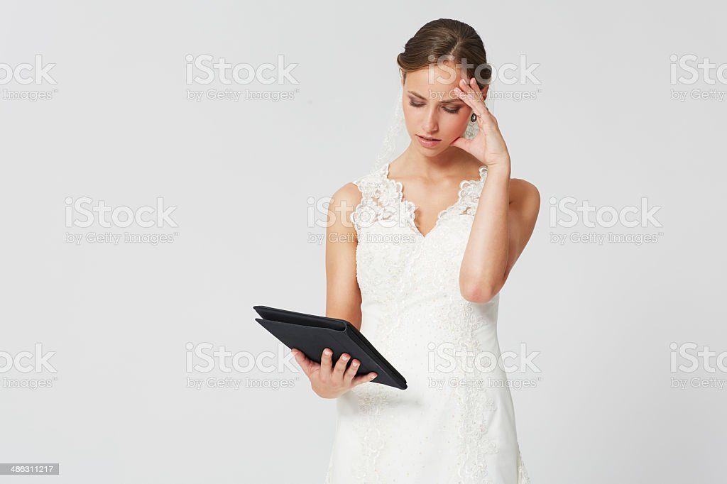 Bride planning her wedding with a tablet stock photo