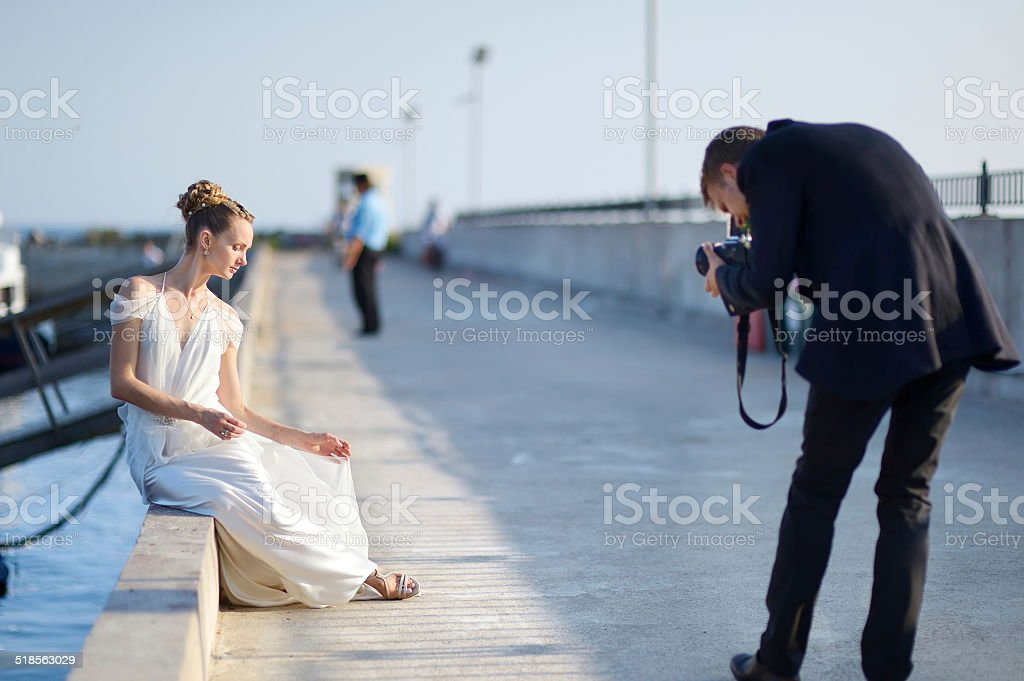 Bride posing for her groom stock photo