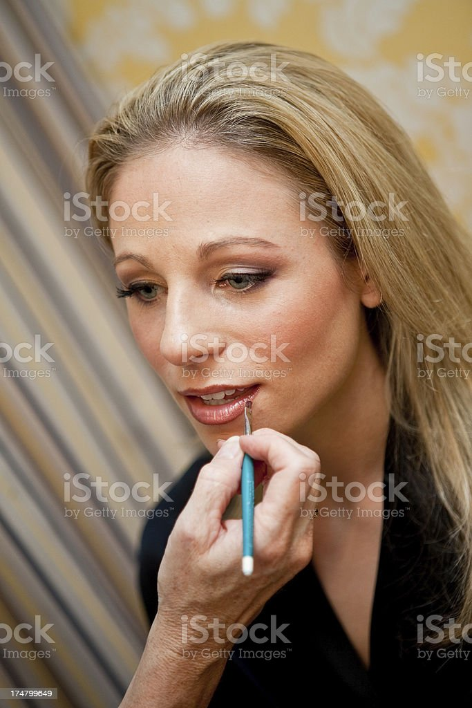 Bride Prepares for Wedding Day with Make-up stock photo