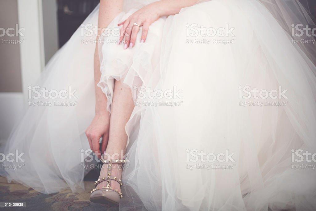 Bride Preparing Her Wedding Shoes stock photo