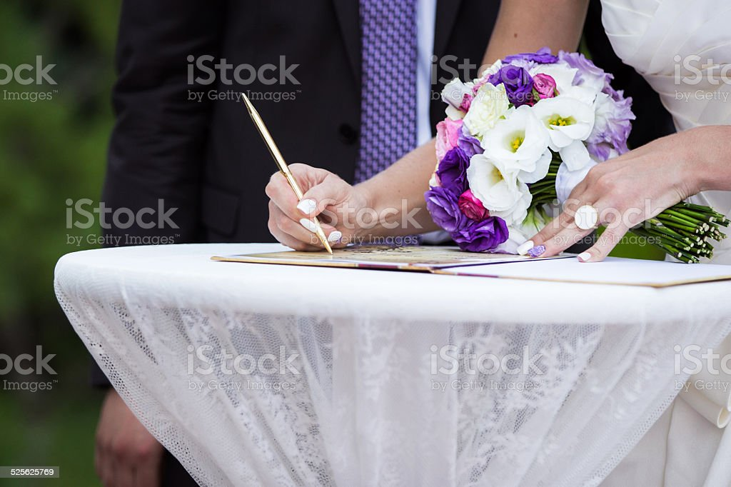 bride puts his signature, wedding decoration royalty-free stock photo