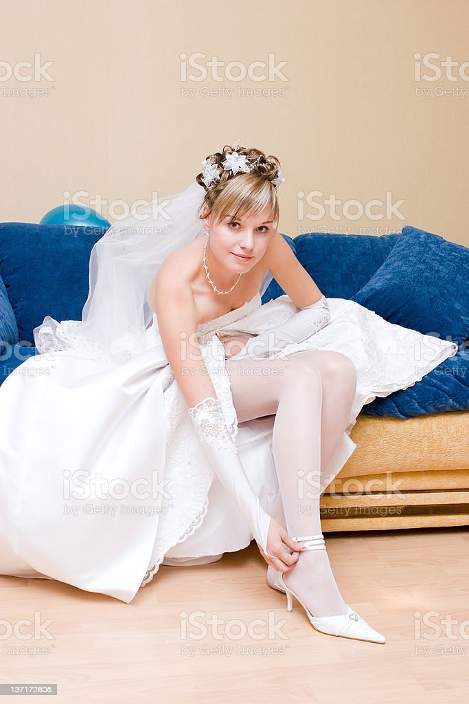 bride putting on a shoe royalty-free stock photo