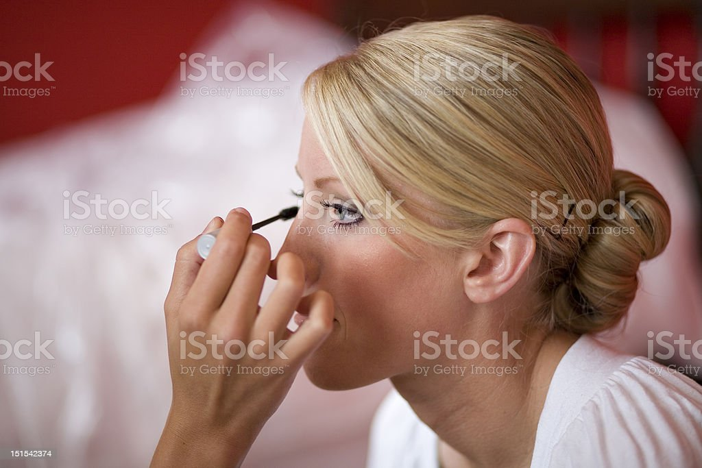 Bride receiving make-up royalty-free stock photo