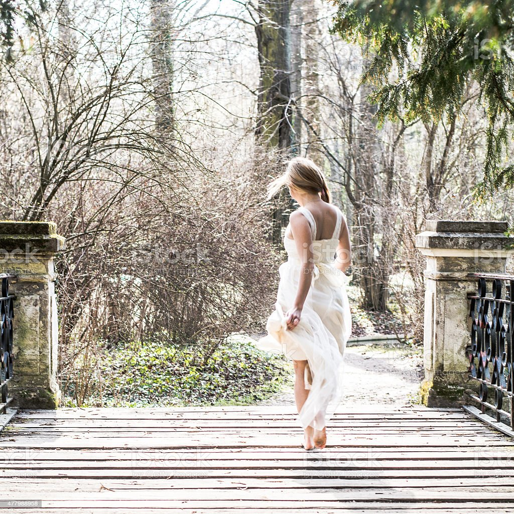 Bride run away stock photo