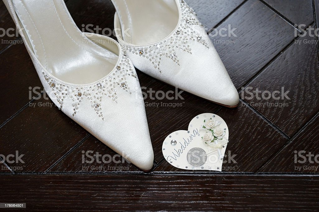 Bride shoes and six pence stock photo