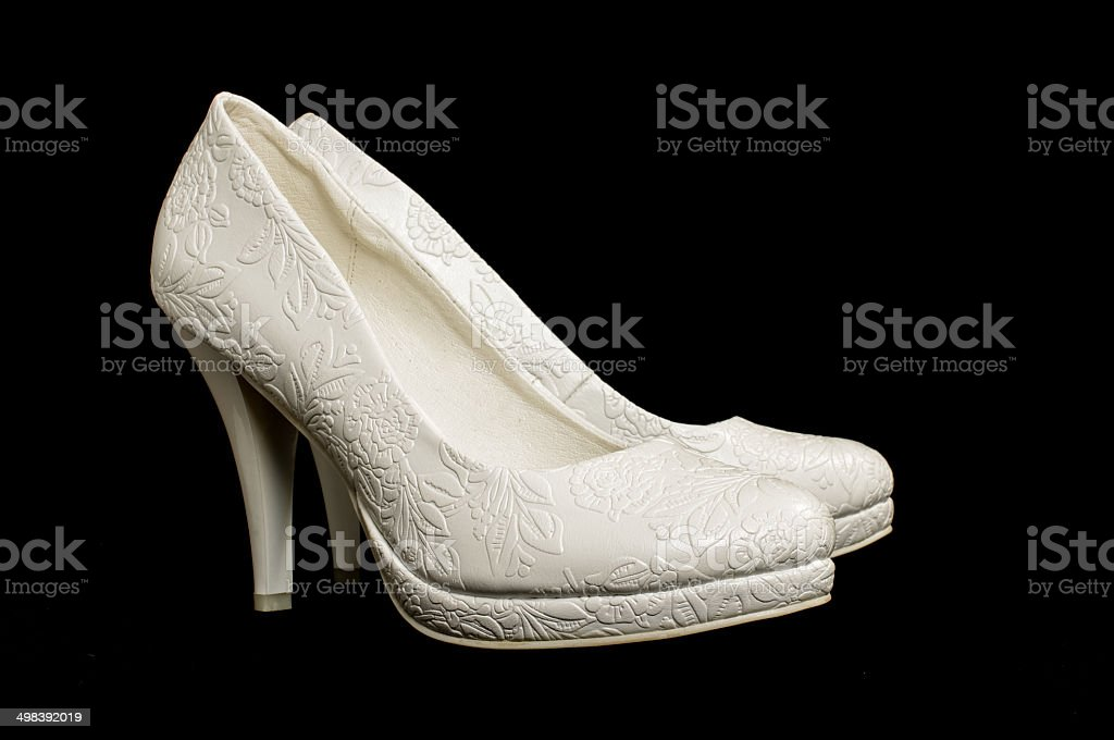Bride shoes isolated on the black background royalty-free stock photo
