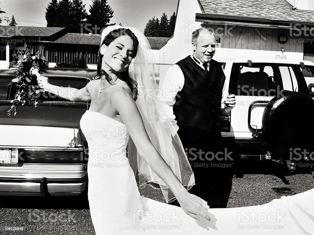 Bride Showing off her Dress Outside royalty-free stock photo