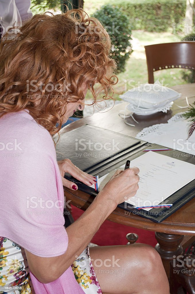Bride Signing Wedding Papers royalty-free stock photo