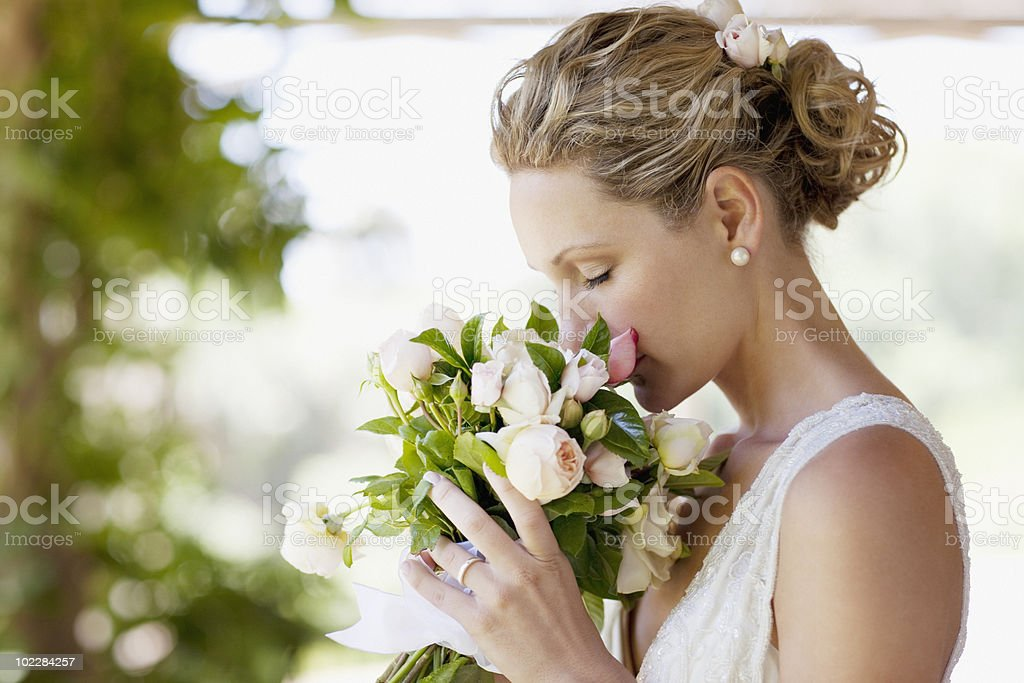 Bride smelling bouquet royalty-free stock photo