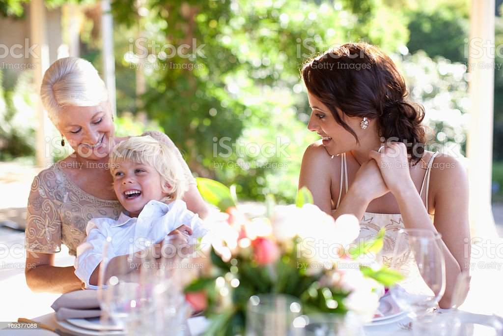 Bride smiling with mother and boy stock photo