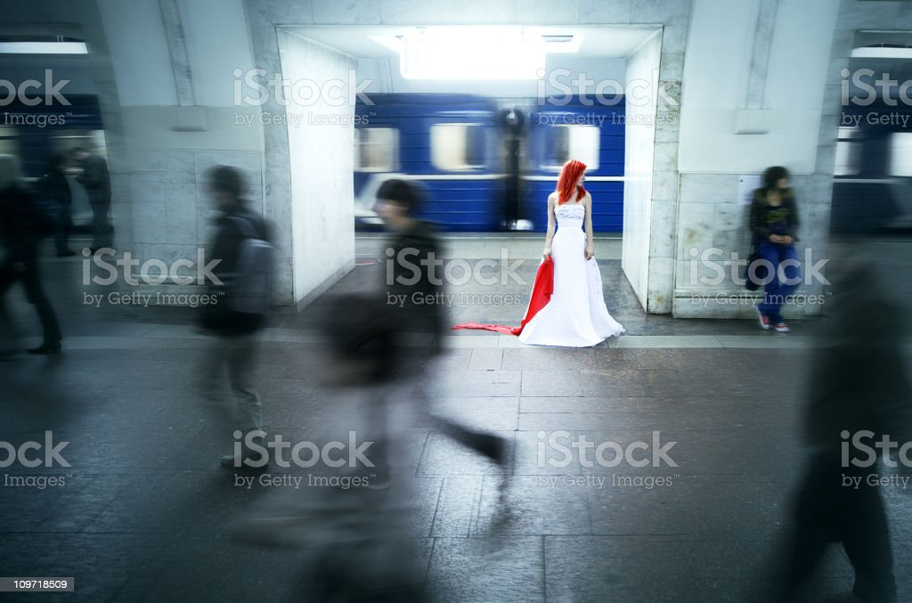 Bride Standing in Subway Station stock photo