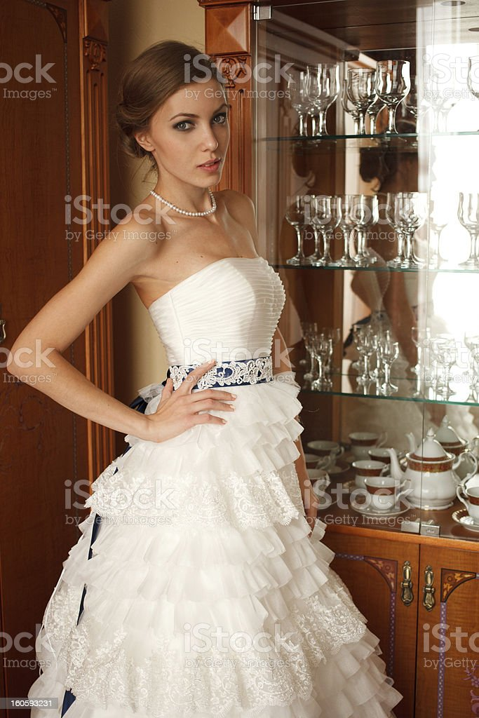Bride stands near cupboard royalty-free stock photo
