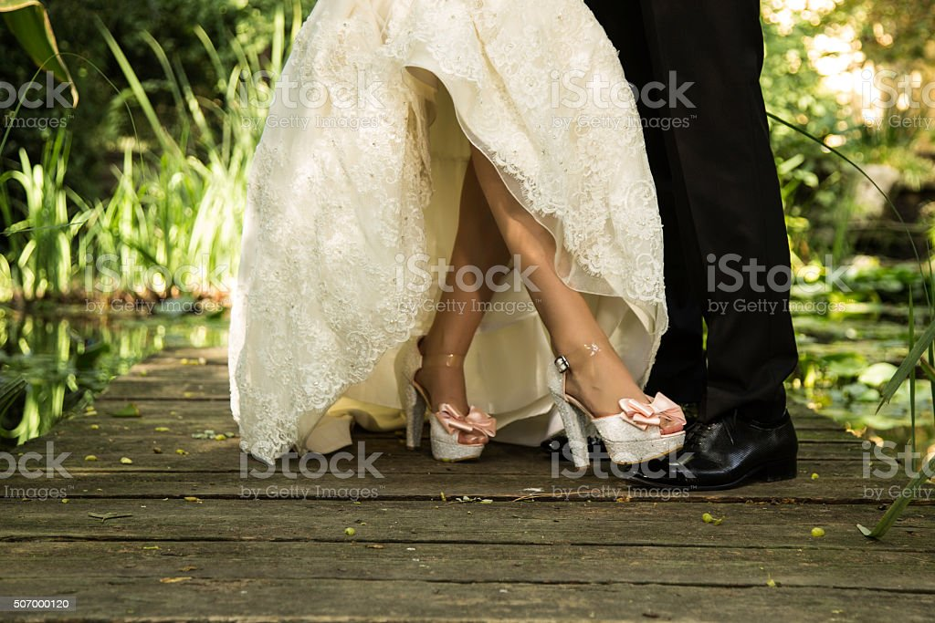 Bride stepped on groom's foot on wedding stock photo