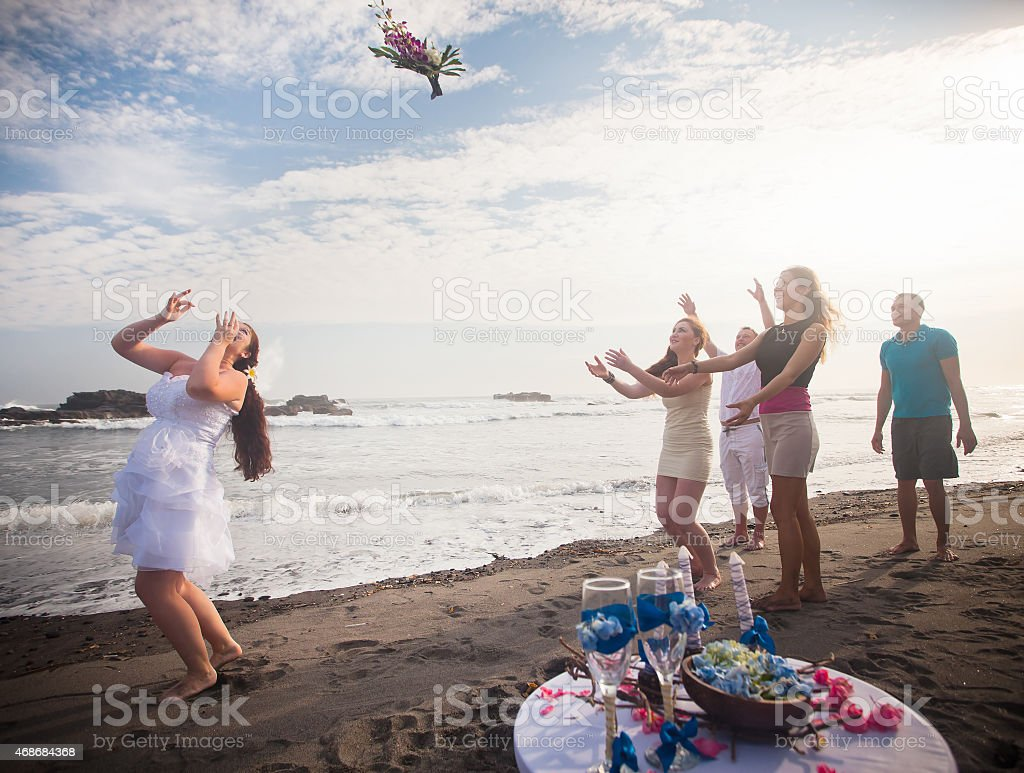 Bride Throwing Bouquet For bridesmaids stock photo