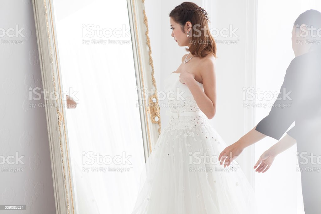 Bride to change to a wedding dress. stock photo
