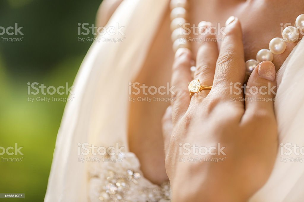 Bride Touching Pearl Necklace stock photo
