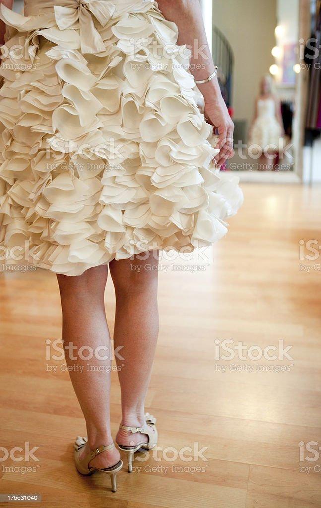 Bride Trying on Wedding Dress royalty-free stock photo