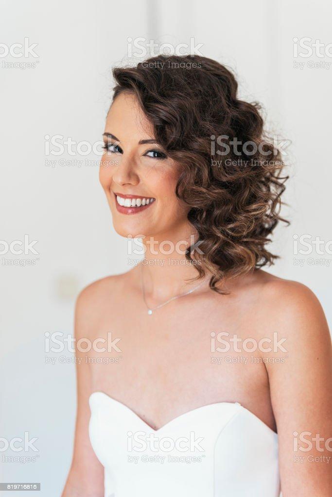 Bride trying on wedding dress. stock photo