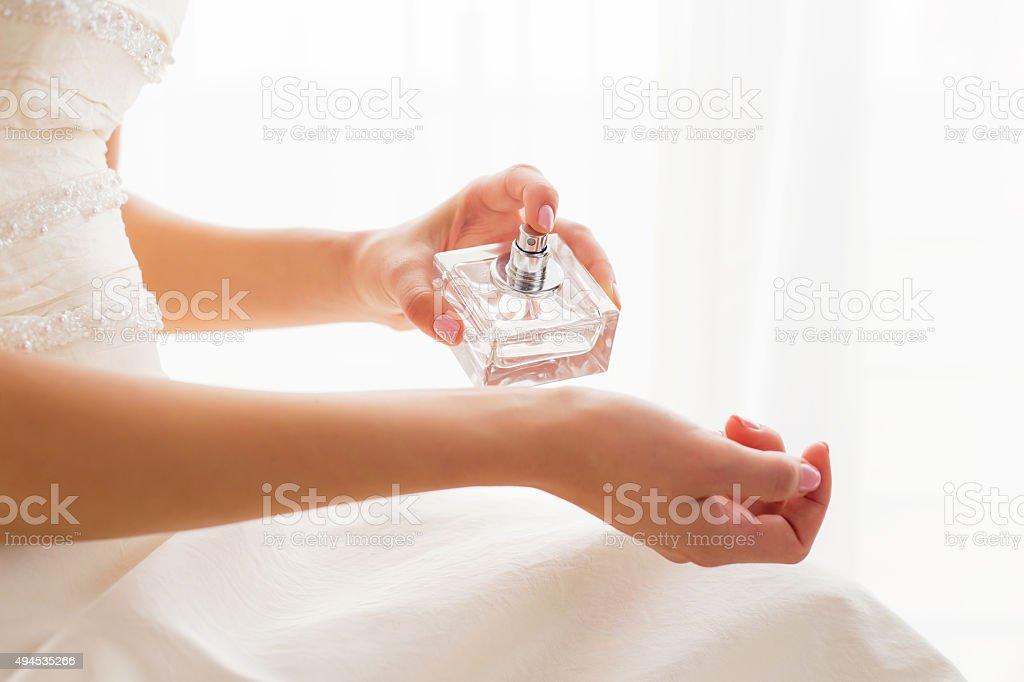Bride using perfume stock photo