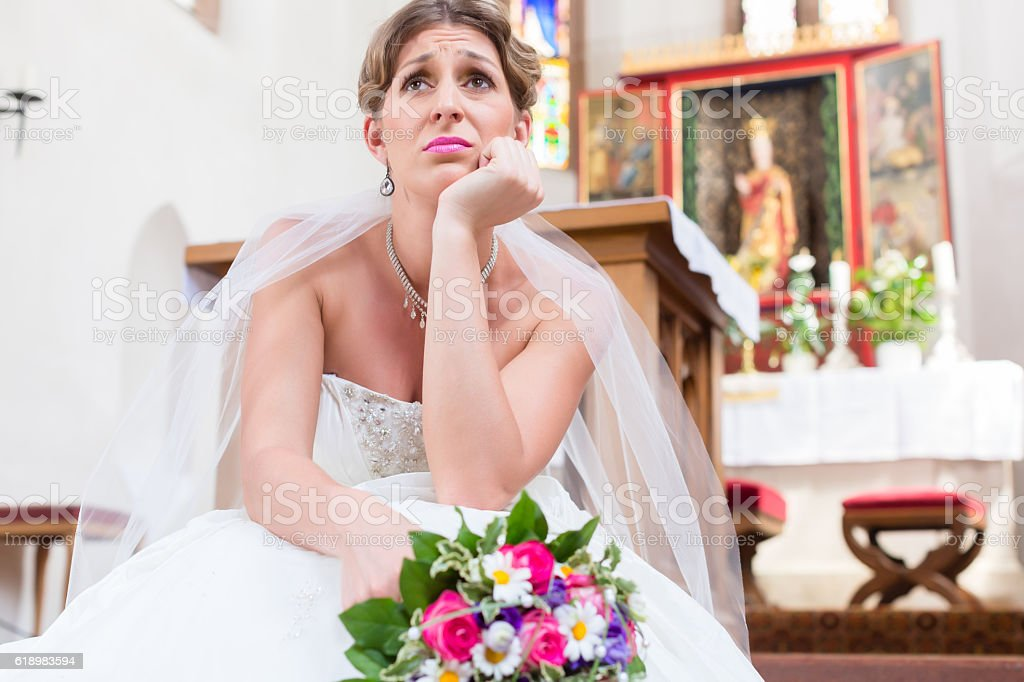Bride waiting alone for wedding being frustrated stock photo