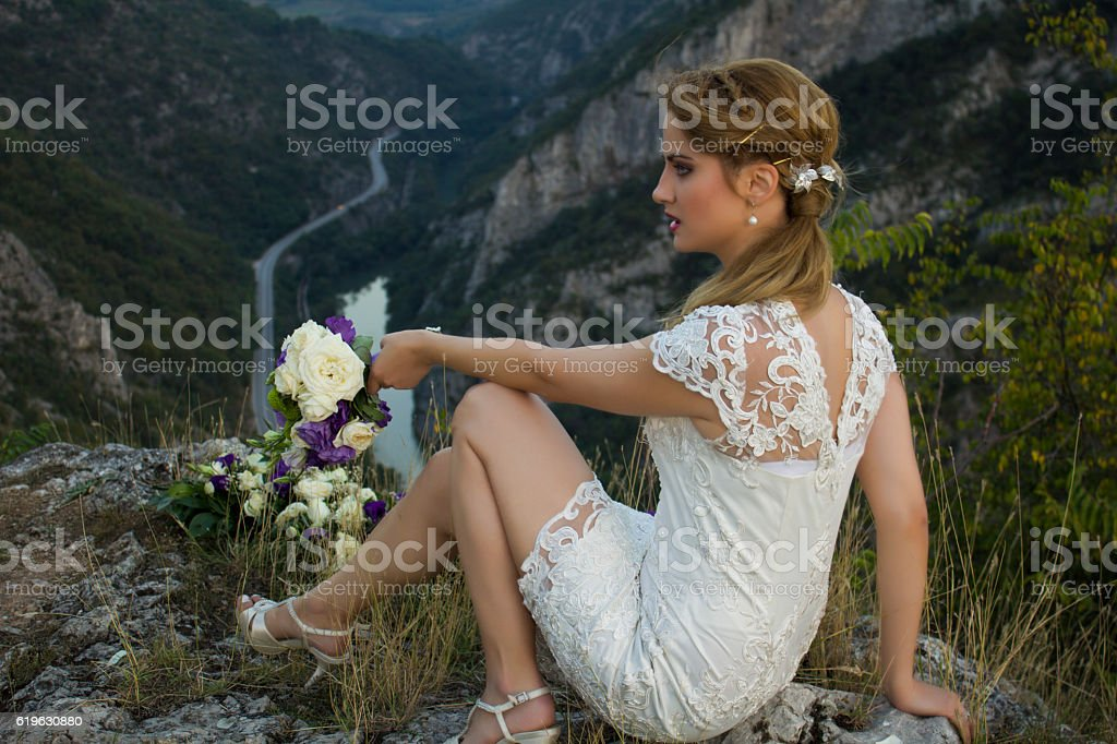 Bride waiting alone for wedding being frustrated. stock photo