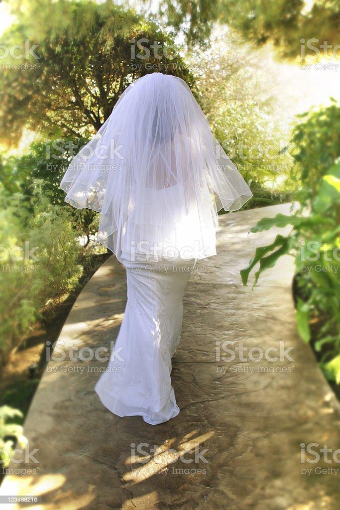 bride walking away stock photo