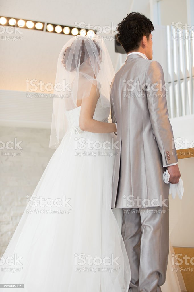 Bride walking forward in chapel at wedding ceremony stock photo