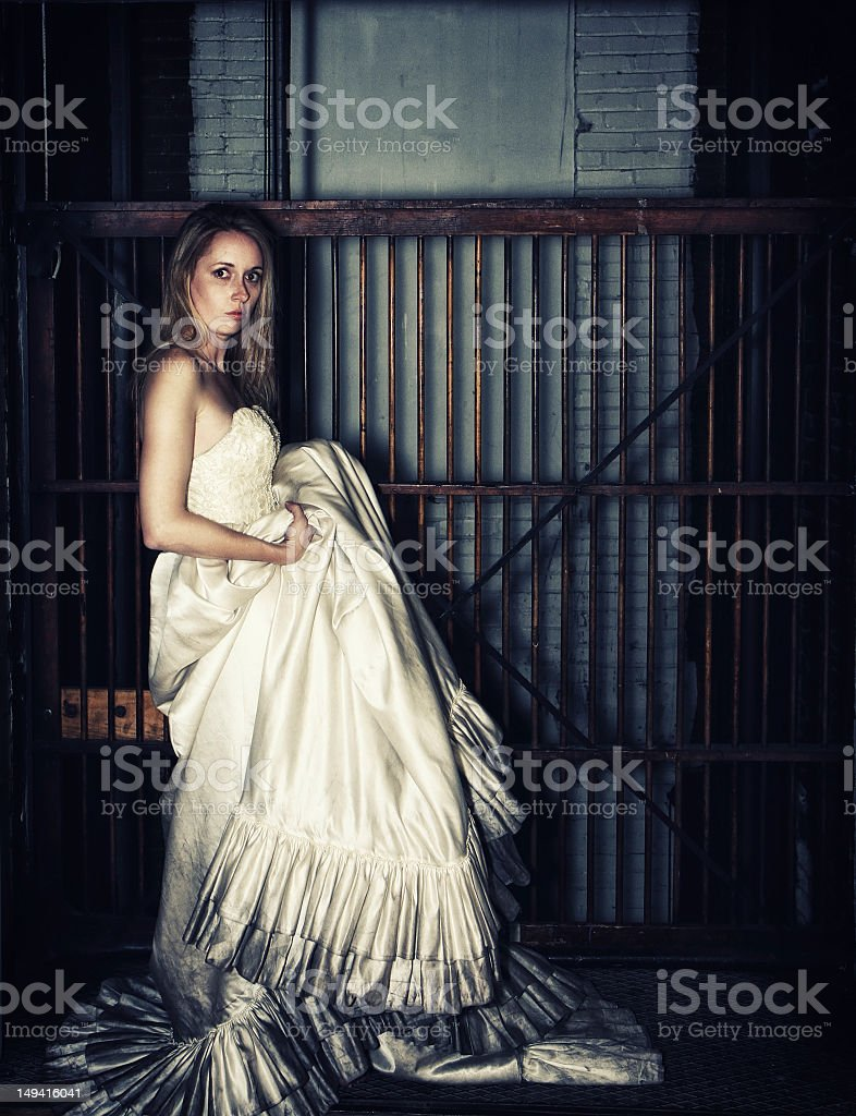Bride Wearing A Sooty Wedding Dress By Old Elevator stock photo