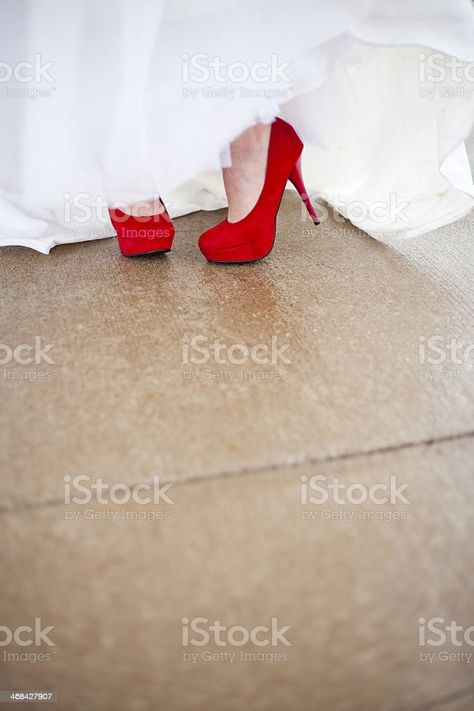 Bride wearing Red High Heels royalty-free stock photo
