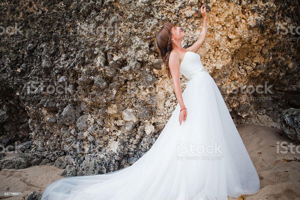 Bride wearing wedding dress stock photo