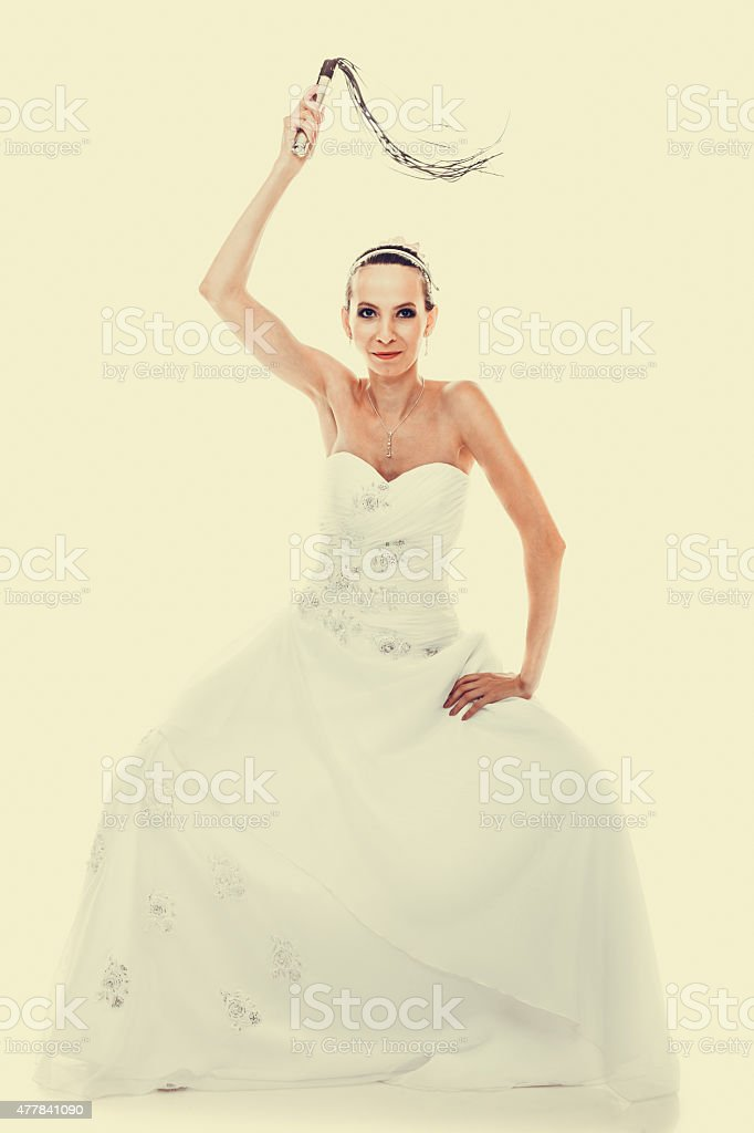 bride white gown holds black leather flogging whip stock photo