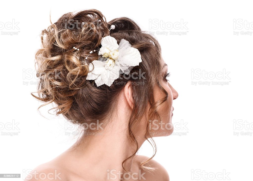 bride with beautiful hairstyle and stylish hair accessory, rear view. stock photo