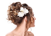 bride with beautiful hairstyle and stylish hair accessory, rear view.