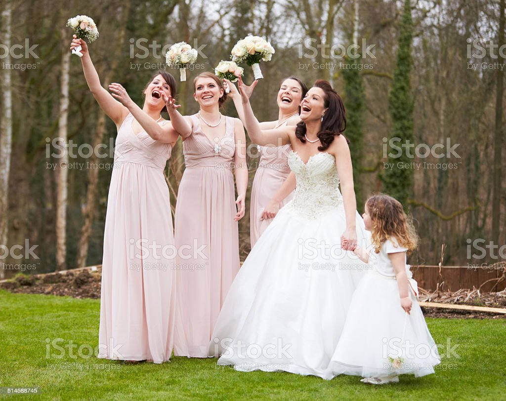 Bride With Bridesmaids On Wedding Day stock photo