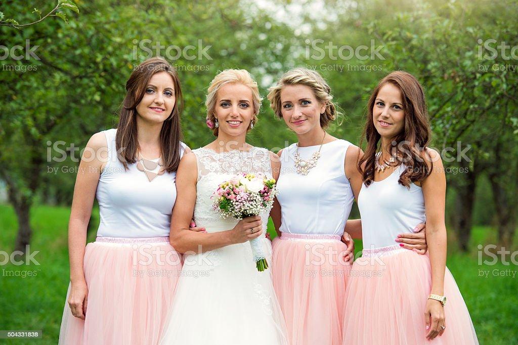 Bride with bridesmaids stock photo