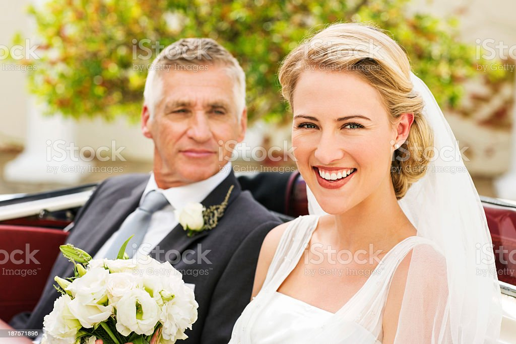 Bride With Father Looking At Her In Convertible Car stock photo