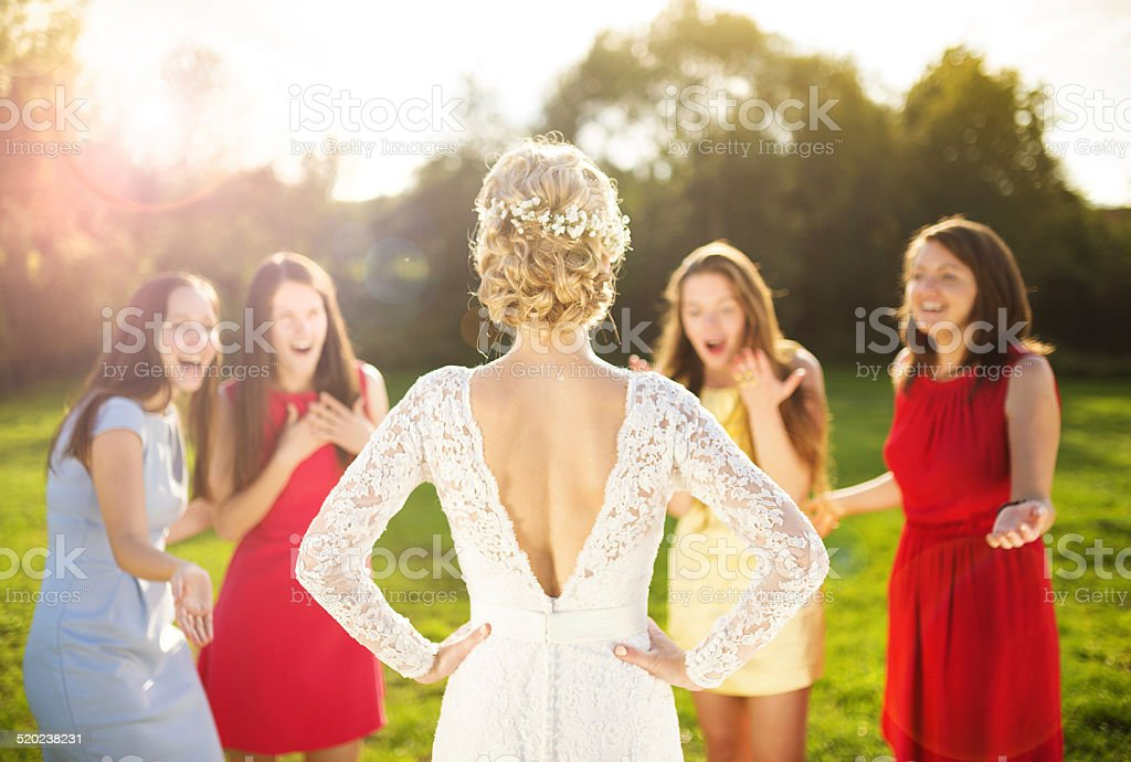 Bride with her friends stock photo