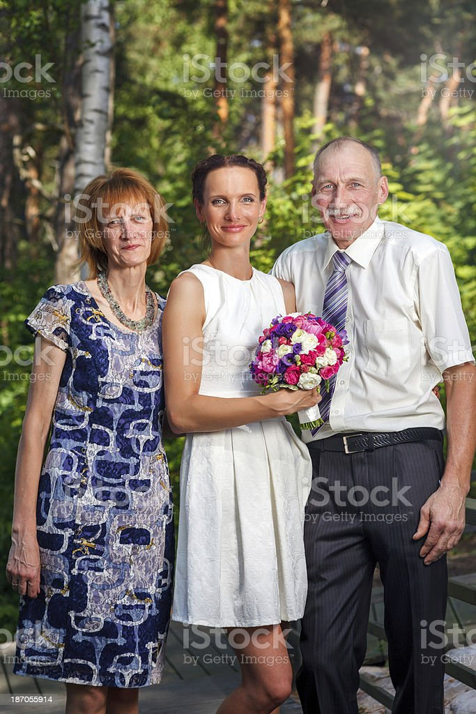 Bride with her parents royalty-free stock photo