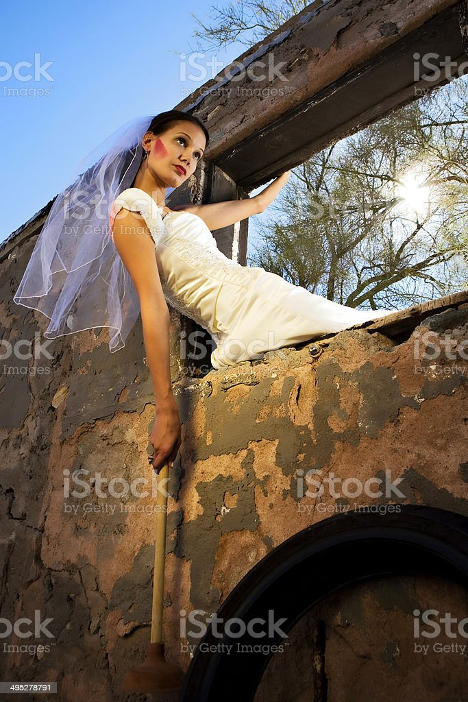 Bride with plunger stock photo