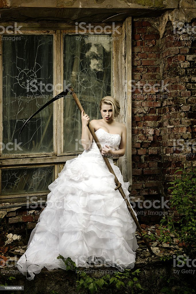 bride with scythe stock photo