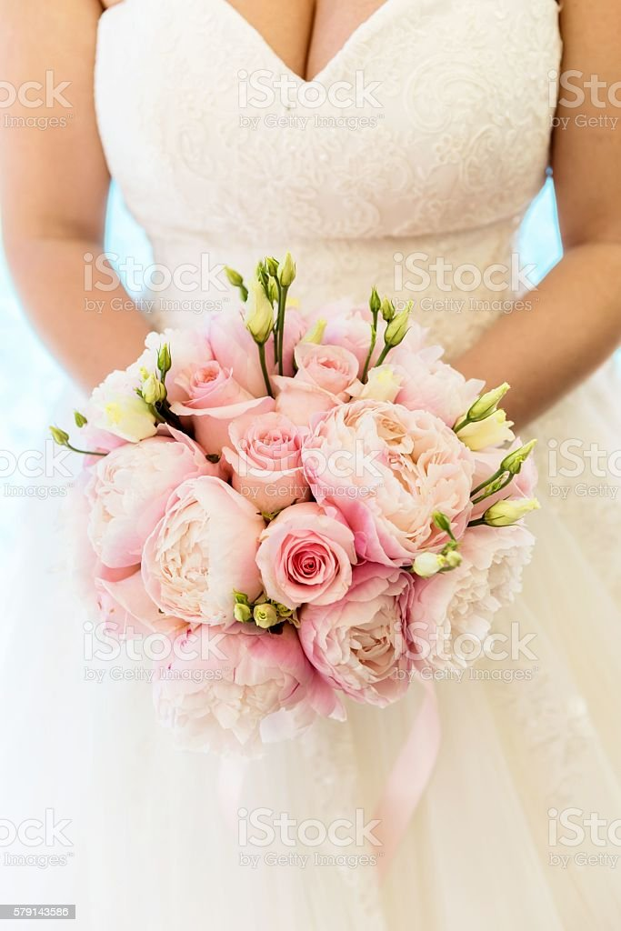 Bride with wedding bouquet stock photo