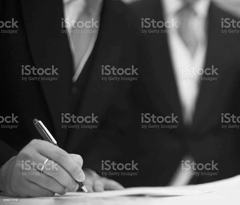 Bridegroom in wedding signing marriage register stock photo