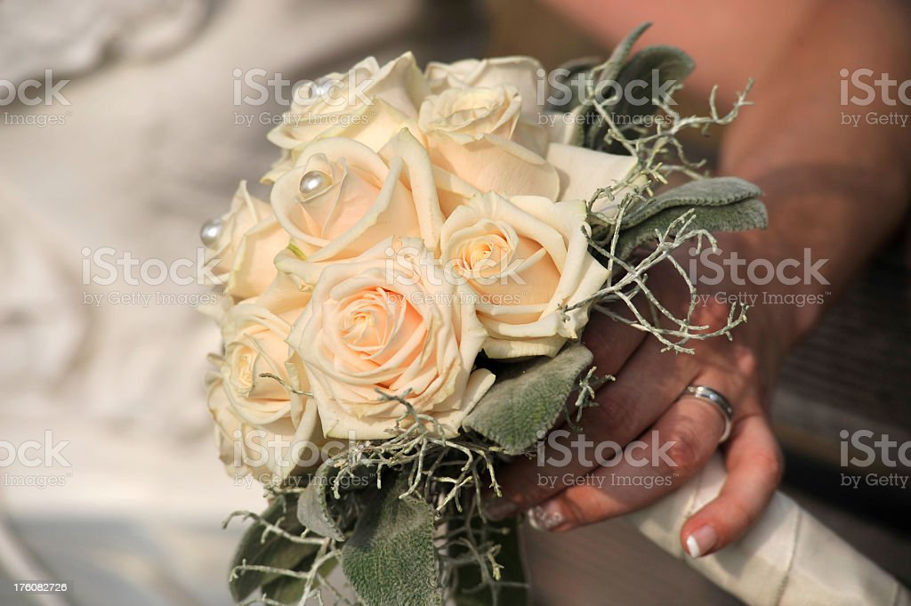 Bride-in-hand holding wedding bouquet royalty-free stock photo