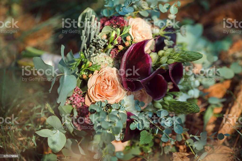 Bride's Bouquet on Green Grass stock photo