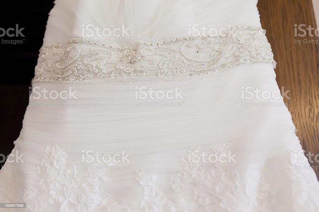 brides dress on a hanger detail shot stock photo