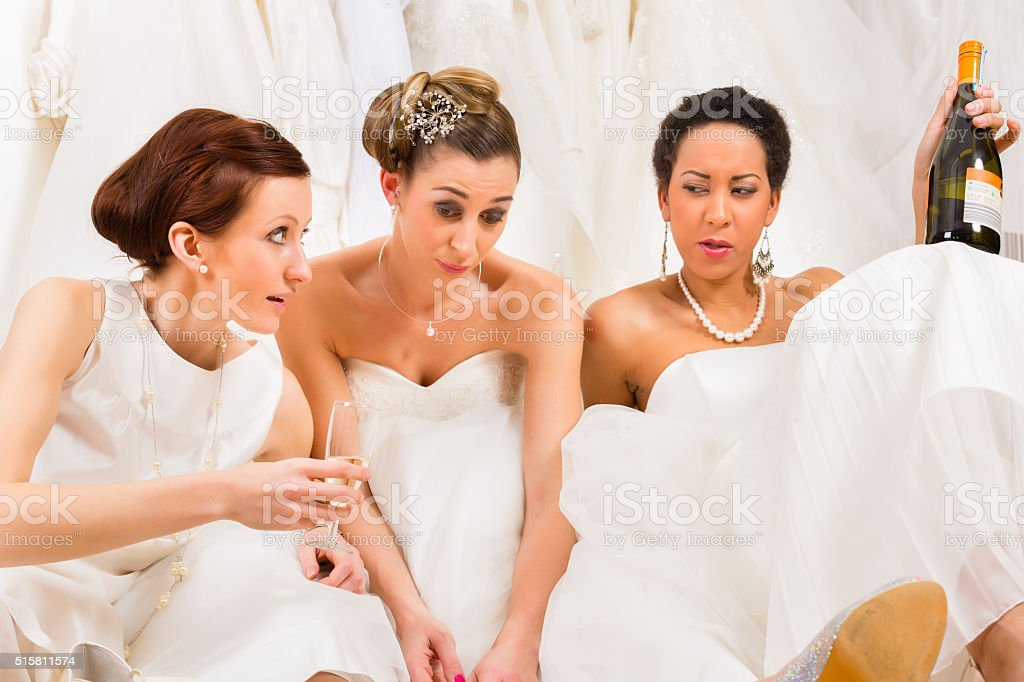 Brides drinking too much in wedding shop or store stock photo