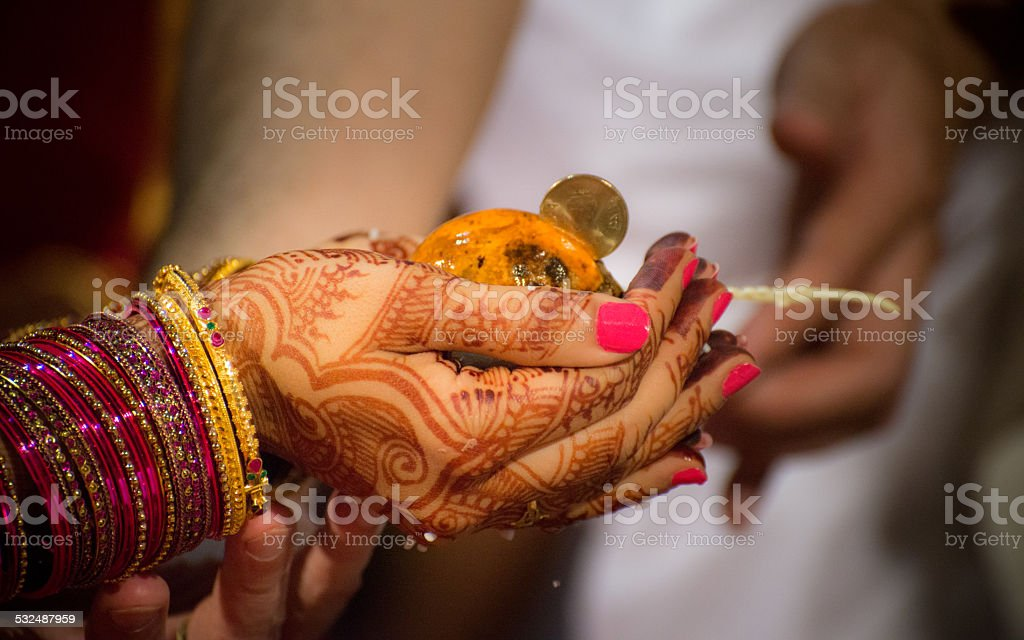 Brides hand on the day of marriage in India stock photo