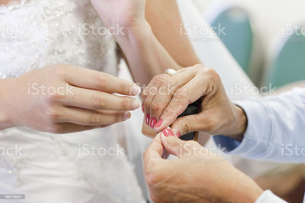 Bride's Hands Accepting Ring from Older Woman royalty-free stock photo