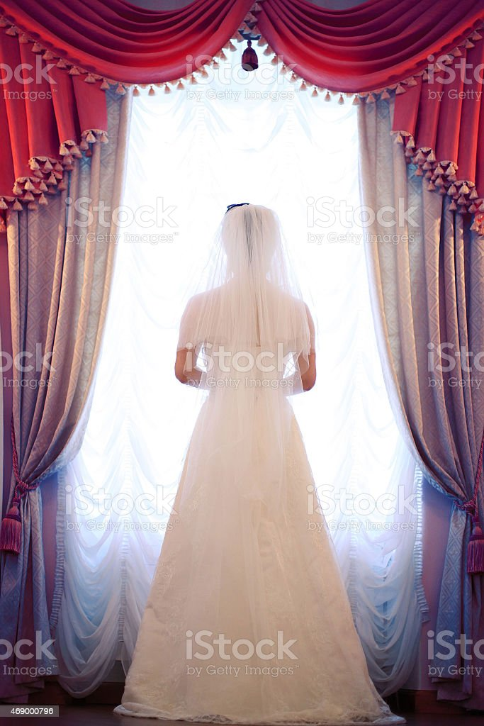 bride's silhouette  at the window stock photo